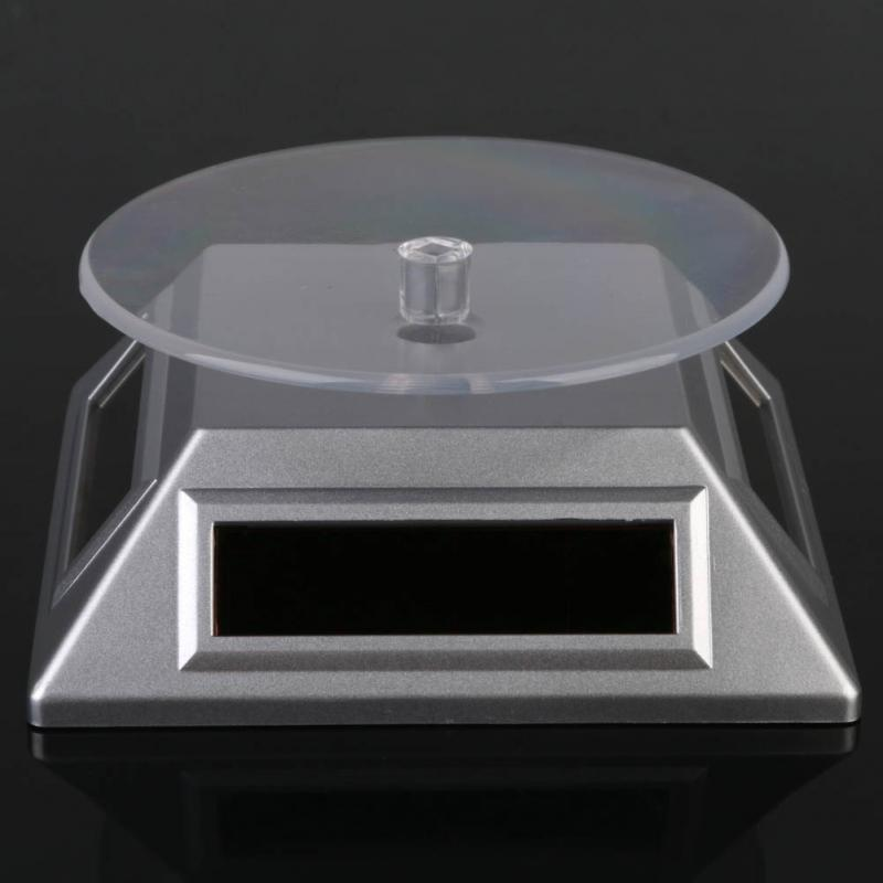 2015 new Exhibition Stand Solar Auto Rotating Display Stand Rotary Turn Table Plate For mobile MP4 Watch jewelry VIP Store(China (Mainland))