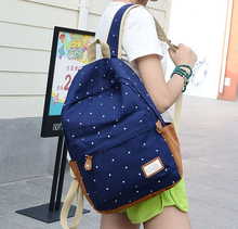 2015 new fasion women backpacks unisex canvas casual backpacks Printed burdens Lovely simple bag travl bag free shipping dh146