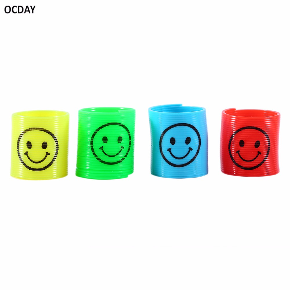 OCDAY 12pcs/set Smiley Springs Kids Toy Rainbow Circles Toys kids Funny Twist Springs Toys Smiling Face Plastic Gifts New(China (Mainland))