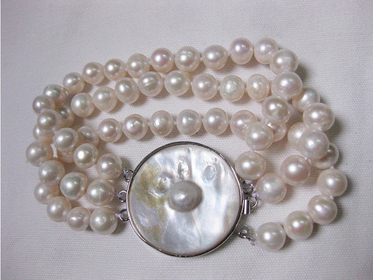 2014 natural 9-10mm Australian AA+ white pearl braclet 7.5-8(China (Mainland))
