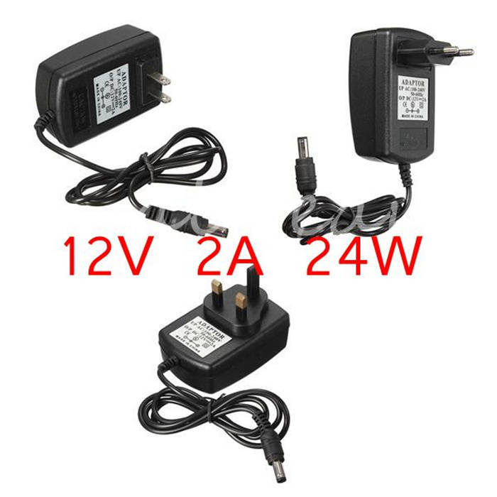 New Universal AC 100-240V US EU UK Plug For DC 12V 2A 24W Power Supply Adapter Charger For LED Strips CCTV Security Camera(China (Mainland))