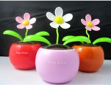 Free shipping Promotion 4pcs/lot Swing Solar Flower,Magic Cute Flip Flap Swing ,Green,Blue,Pink Solar Plant Swing Solar Toy(China (Mainland))