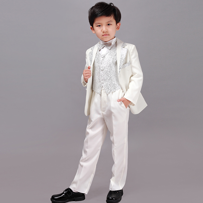 Boys Tuxedos Baby Toddler, Children's Tuxedos Kids Tuxedos. You're used to seeing two-button notch lapels as different suits. A tuxedo, besides having satin on the lapel, is defined by having a peak lapel. The peak, even though is the most traditional, is not the most popular. In fact, it doesn't sell very well at all right now.
