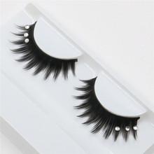 a pair of false eyelashes encrusted exaggerated fashion glitter lashes