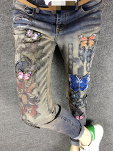 Europe New Winter Butterfly Sequin Slim Stretch Feet Long Printing Bronzing Female Spot patchwork flower printed women Jeans(China (Mainland))