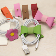 Mobile phone tie-line belt earphones data cable tie-line buckle management-ray device cable(China (Mainland))