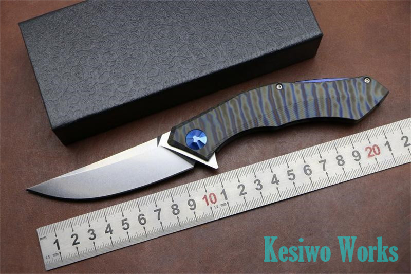 Kesiwo folding hunting knife titanium handle 59HRC D2 Blade camping outdoors survival tactical pocket knife bearing tools(China (Mainland))