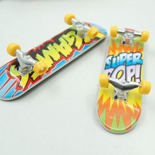 2015 cartoon Anime Professional Finger Skateboard zinc alloy Stents Bearing Wheel Fingerboard Adult Novelty Items Children Toy(China (Mainland))