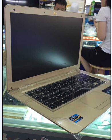 ultra thin notebook laptop 14inch screen size without ram and hard drive free delivery(China (Mainland))