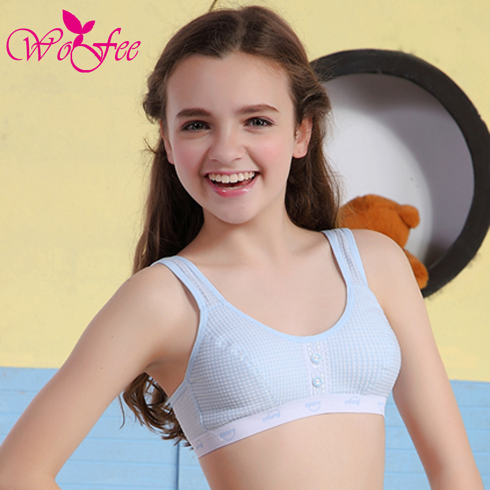 Tiny young girl first in bra