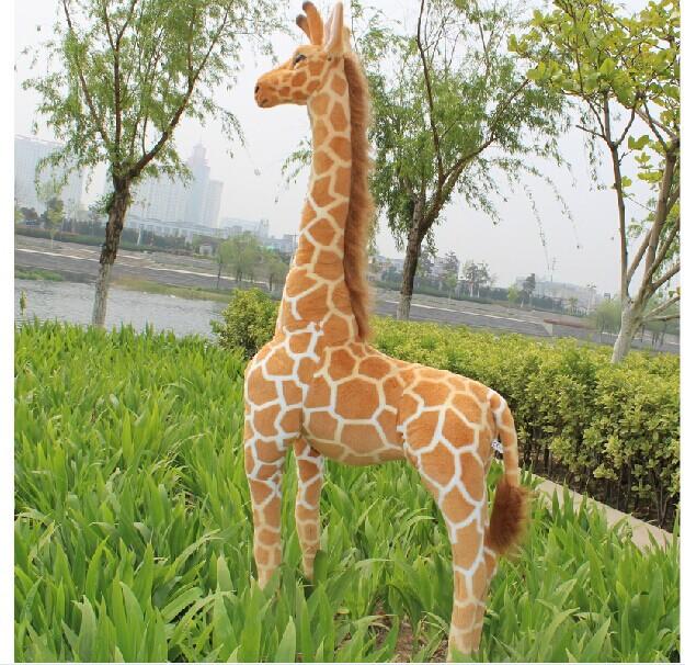 Фотография simulation giraffe toy lovely standing plush doll soft giraffe doll birthday gift about 95cm