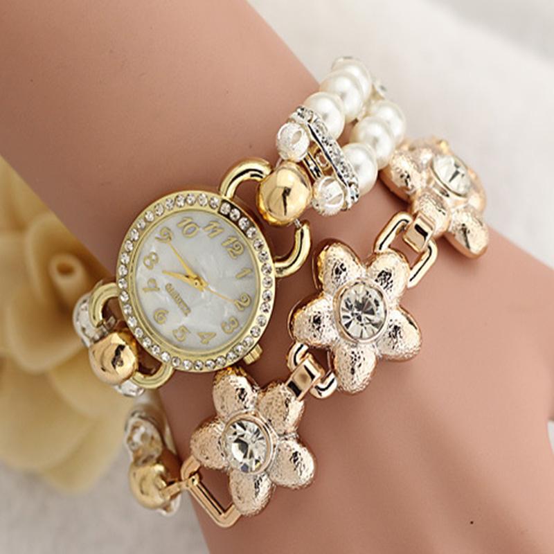 2015 Watches Women Famous Brand Luxury Famous Lotus Flower Wrist Watch Bracelet Lady Golden Chain Clock Female Reloges <br><br>Aliexpress