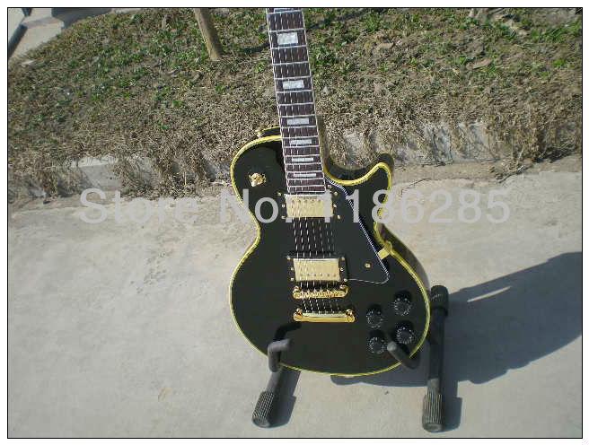 Free shipping Chinese musical instrument diamond logo yellow binding black beauty les gbson paul lp electric guitar(China (Mainland))