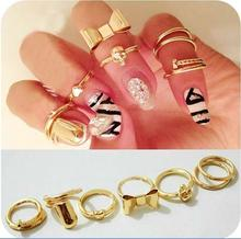 7Pcs Hot Gold Color Skull Bowknot Heart Nail Simple Band Mid Finger Rings Set for Women