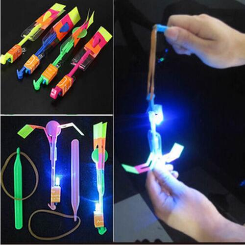 100pcs LED Light Slingshot Elastic Arrow Rocket Helicopter Flying Toy Party Fun Gift - Color Random