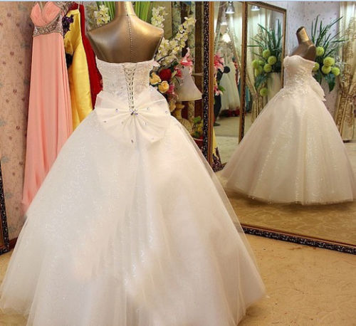 2015 luxury bling crystal wedding dress sleeveless for Strapless wedding dresses with bling