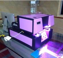 A4 size UV printer for leather sheat,PU bag, PVC plate, Acrylic plate(China (Mainland))