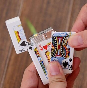 Creative industries as their poker electric person lighter on their boyfriend birthday gift to get an electric shock toys(China (Mainland))