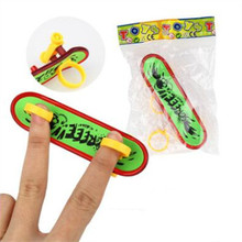 Mini Plastic Fingerboard Professional finger skateboard for kids novelty items Toy Finger Skate with spring and ring(China (Mainland))