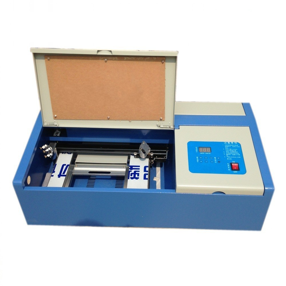 desktop CO2 laser engraving machine for rubber stamp and other small non-metal material engraving(China (Mainland))