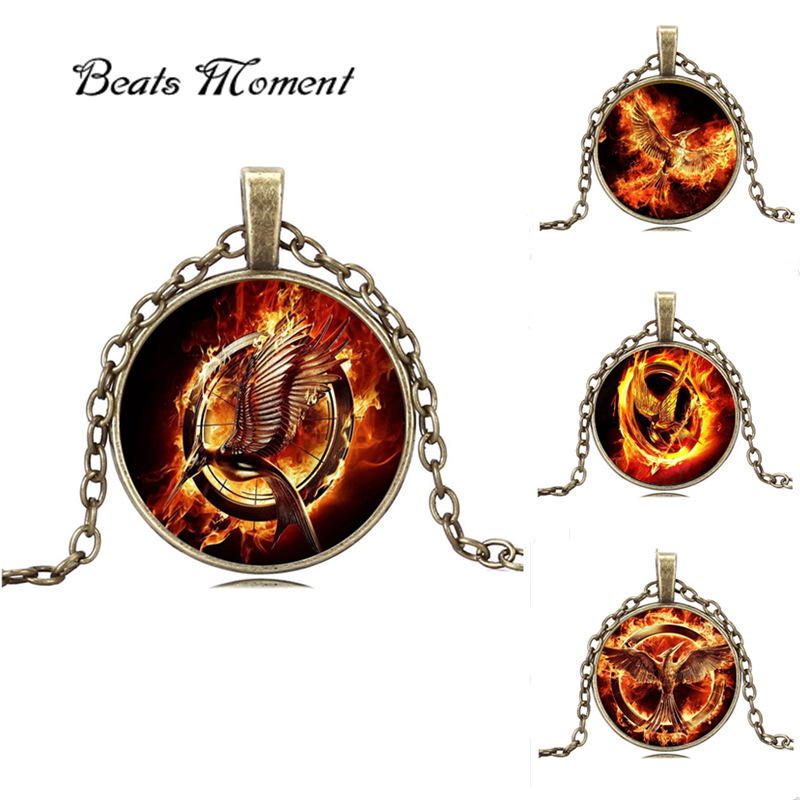 Hunger Games Necklace B&M 2016 Hot Sale Retro Punk Round Glass Laugh Birds Hungry Games Necklace Parrot Bird Pendant Necklace(China (Mainland))