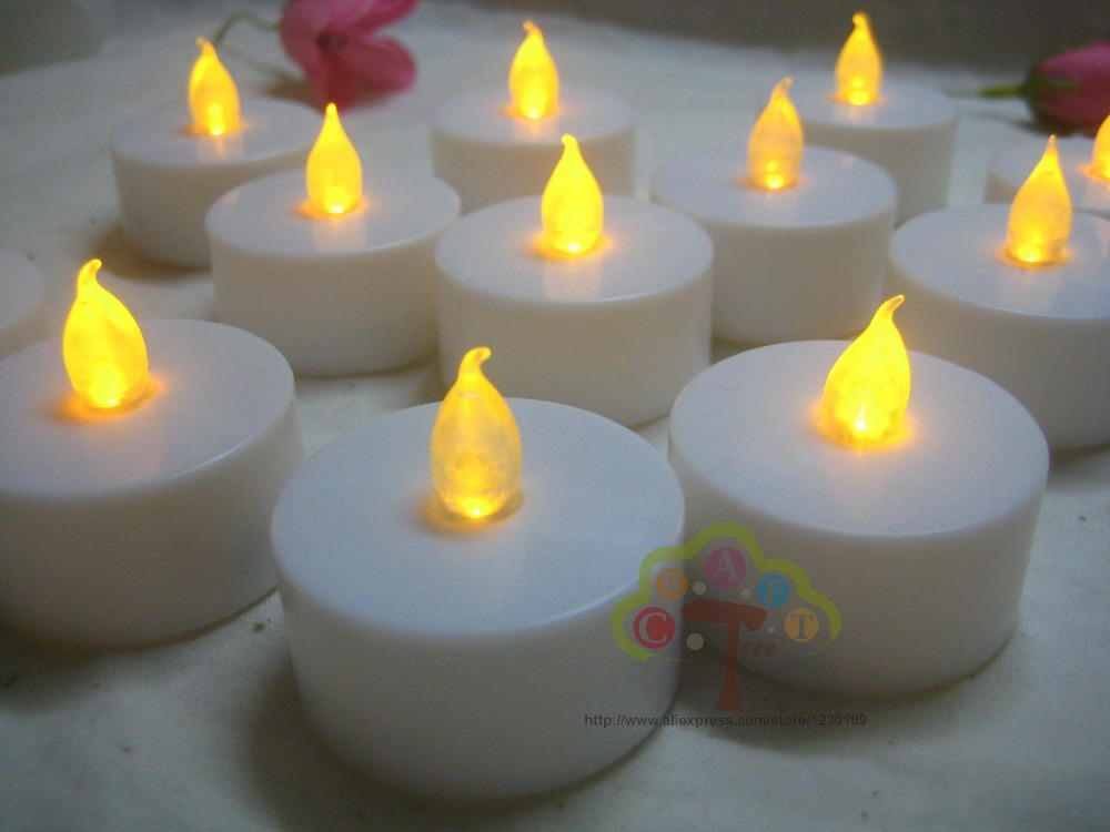 Free Shipping 12pcs/Lot LED Tealight Candle Flameless Tea Light Electronic Candle For Home Decor Dinner Party Wedding DIY Craft(China (Mainland))