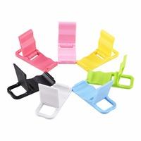 Vendite calde colorful universale pieghevole supporto del basamento del telefono cellulare mini desk stazione di plastica supporto del basamento per ipod iphone suporte