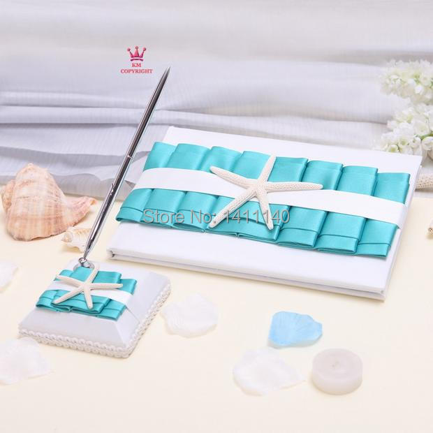 elegant blue wedding guest book and pen set for beach wedding theme