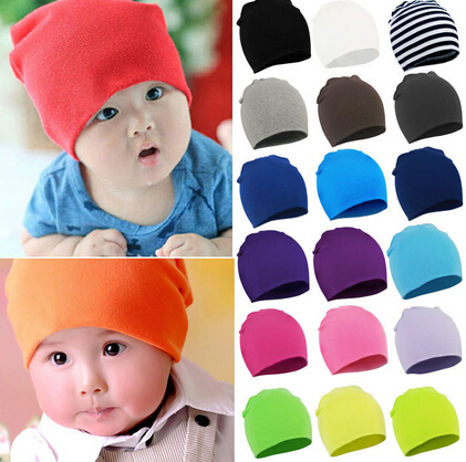 Hot Sale! 2015 Lovely kids baby hat cap for boys girls solid color soft hat free shipping thick baby cold cap super pocket hat(China (Mainland))