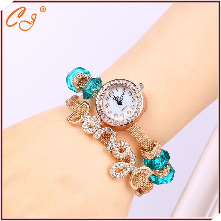 The new incoming LOVE ms diamond-encrusted bracelet watch Gold crystal big quartz watch students around tables(China (Mainland))