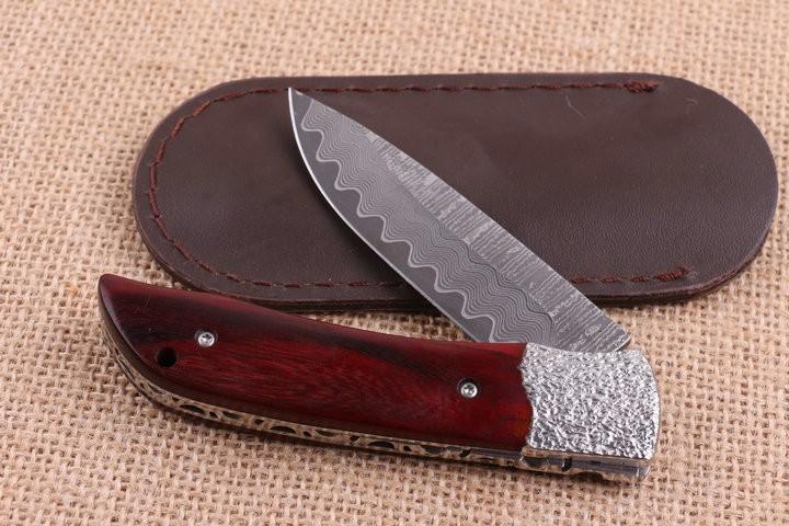 Buy New pocket folding knife Damascus steel  camping hunting survival pocket gift knife sandalwood handle utility hand tools cheap