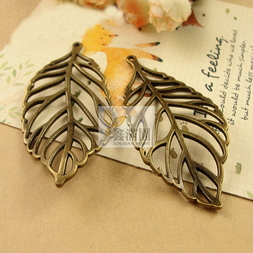 (20 pieces/lot) antique bronze plated metal zinc alloy vintage style big hollowing leaf pendant jewelry hd2638(China (Mainland))
