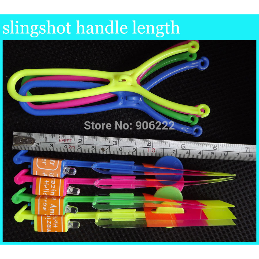 (50 pieces/lot) Slingshot Toy Amazing Arrow Helicopter Rubber Band Power Copters Kids Led Flying Toy(China (Mainland))