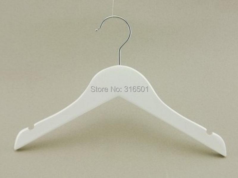 white wooden hangers 2