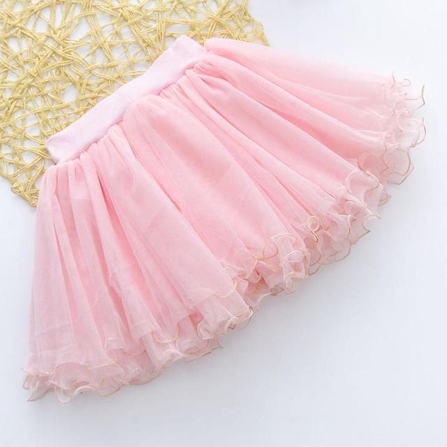 2016 детей марлевые юбки летом новый яркий бусины золотой секрет боковой девушки короткая юбка