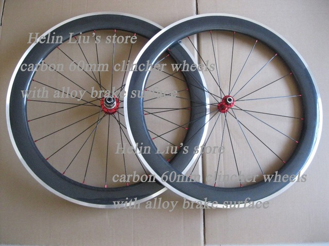 The latest carbon alloy clincher wheels 60mm with Red Powerway R13 hubs and Black spokes