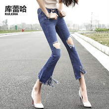 New ripped jeans women fashion popular spring-summer flared jeans low waist for females with pockets and tassels at the hem(China (Mainland))