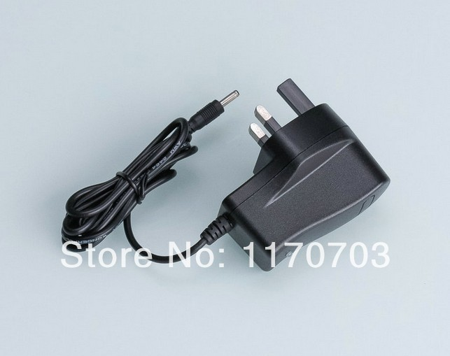 Universal UK Power Adapter supply AC DC Charger 8.4V 1A for 18650 battery pack(China (Mainland))