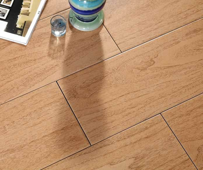 Can i tile over vinyl flooring
