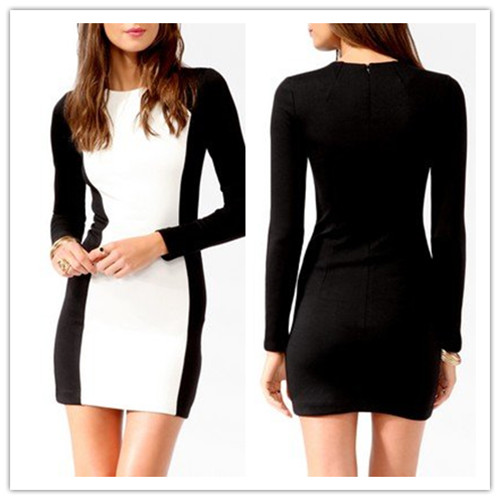 A women's size large dress from White House Black Market. The dress is in black and white with a geometric pattern. The dress is lined, faux wrap, v-neckline, 3/4 length sleeves, knee length and wear to work.
