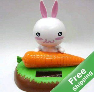 Cute solar doll--rabbit eating carrot+Free shipping(China (Mainland))