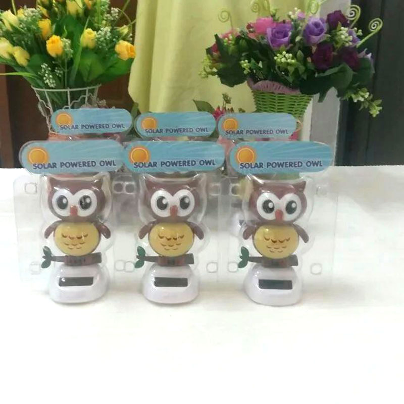 Wholesale Price 10 Pieces Per lot Swing Under Full Light No Battery Flip Flap Dancing Owls Solar Powered Novelty Toys(China (Mainland))
