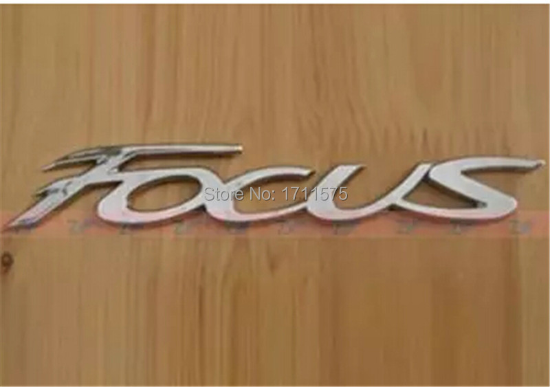 Free Shipping Rear Emblem for 2012-2013 Ford FOCUS Electroplated Silver Special-purpose Tail English Standard Letter Emblem(China (Mainland))