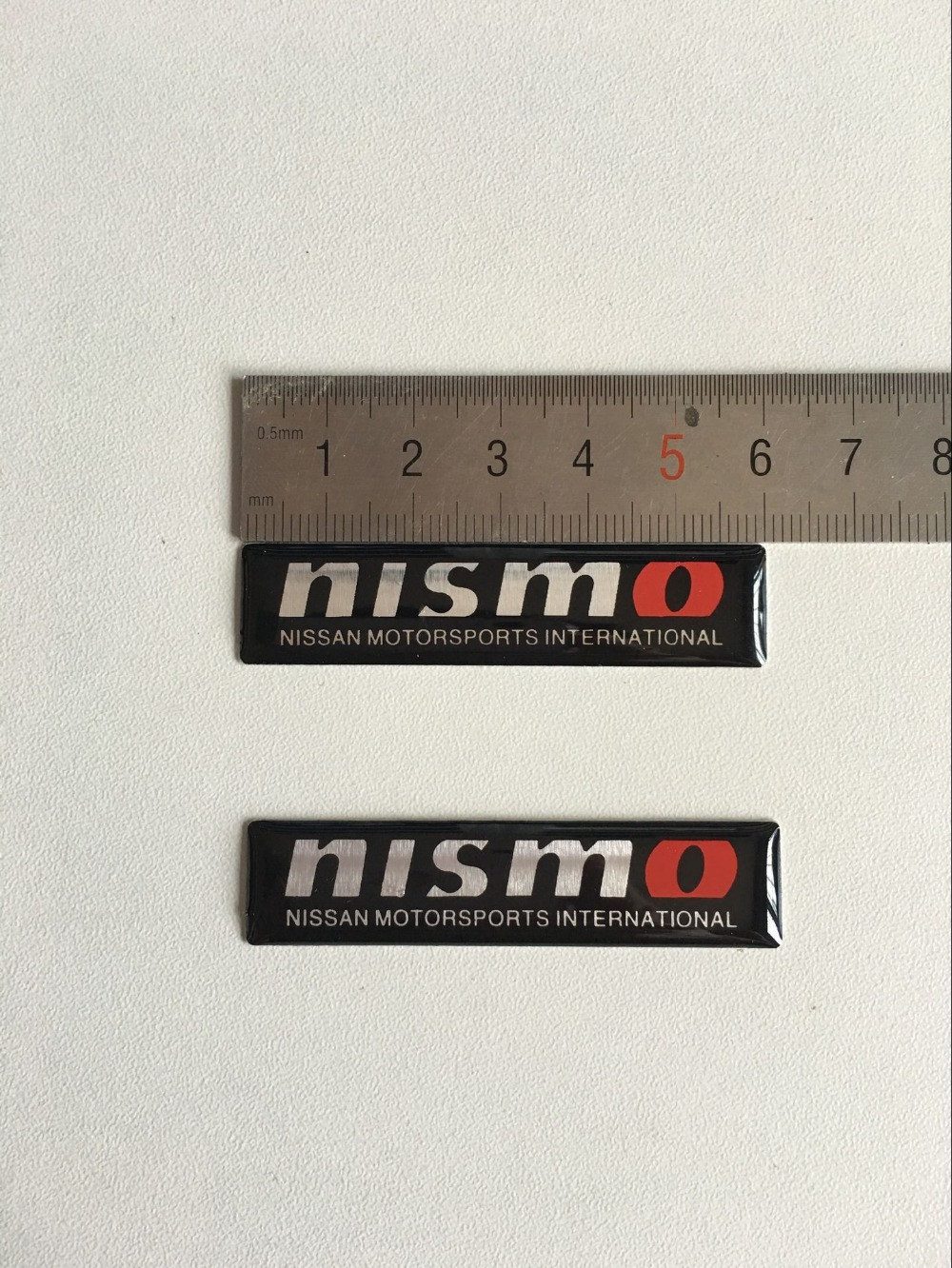 2pcs/lot automobile accessories car body styling stickers with for for Nissan Teana X-Trail Livina nismo logo emblem badge(China (Mainland))