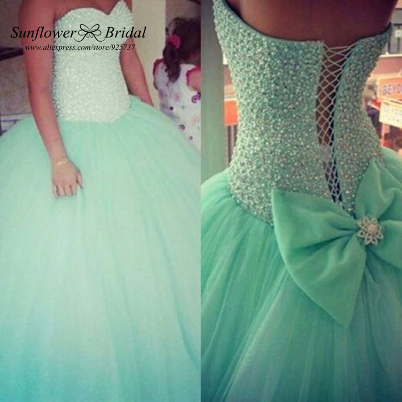 Sexy Sweetheart Crystals Pearls Corset Bow Bandage Ball Gowns Organza Mint Green Quinceanera Dresses vestido 15 anos festa(China (Mainland))