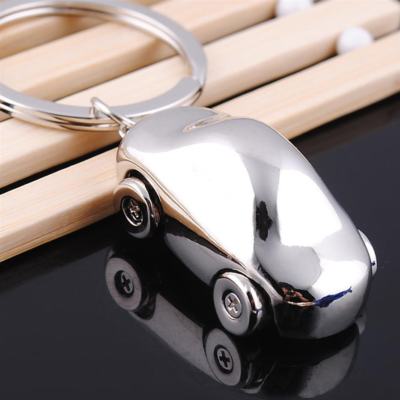 2015 originality Germany sedan car keychain four wheels exquisite explosion models ornaments personality small gifts(China (Mainland))