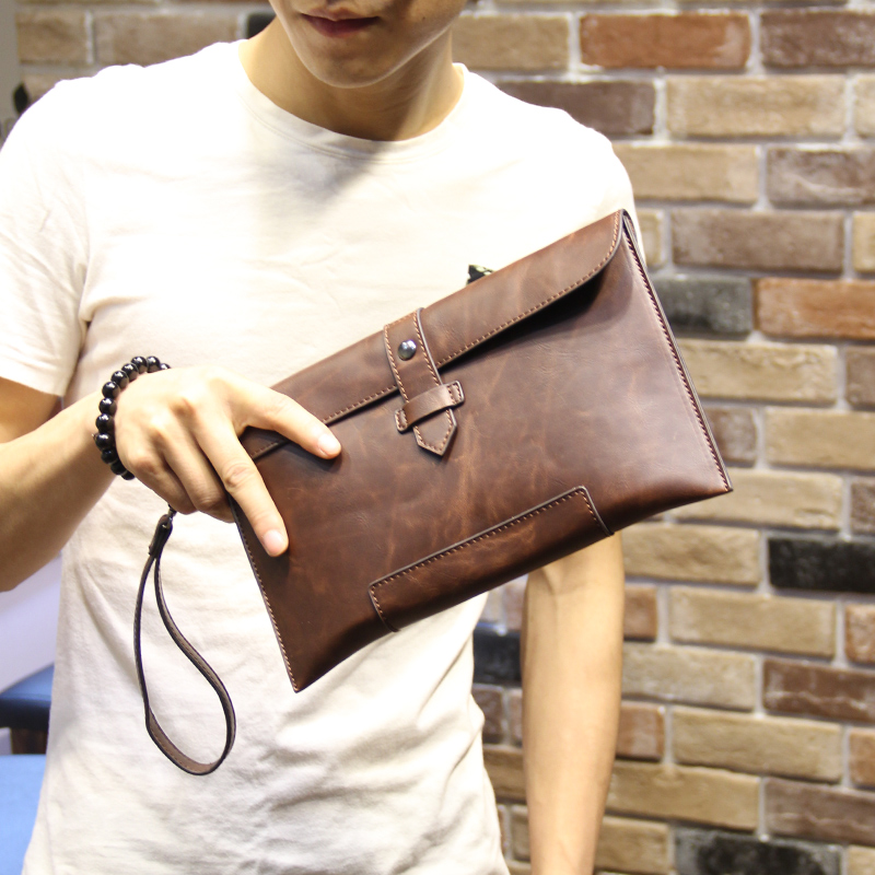 2015 new men's hand bag Korean male bag business Metrosexual Envelope Clutch leisure bag free shipping simple style(China (Mainland))