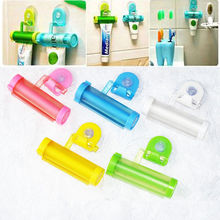 1 pc Plastic Rolling Tube Squeezer Useful Toothpaste Easy Dispenser Bathroom Holder Free Shipping(China (Mainland))