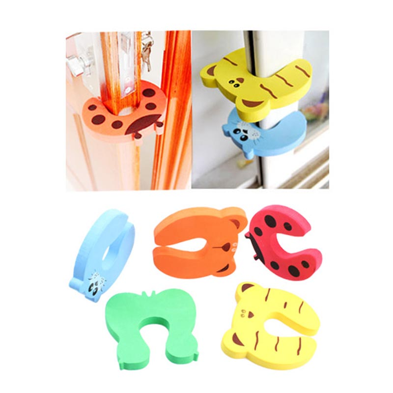 4pcs/set Baby Safety Door Stop Finger Pinch Safety Guard Baby Helper Door Stop Finger Pinch Guard Lock Color by Random(China (Mainland))