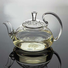 Glass tea pot 600ml,flowering high borosilicate glass teapot with a stainless steel ball inside for filtering,hot sale teapots(China (Mainland))